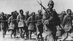 Chinese soldiers recently captured march away in to captivity.