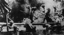 The speed of the Japanese advance into Malaya often depended on improvisation, which is shown here as soldiers hold up a makeshift bridge.
