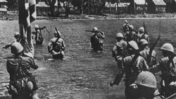 Japanese troops wade ashore at Vigan, to the north of Lingayen Gulf, on the 10th December 1941.