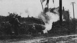 An American soldier flushes out Japanese defenders on Guam with his M1 flamethrower.