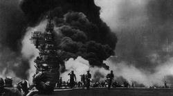 The USS Bunker Hill is hit for the second time in 30 minutes by a Kamikaze.