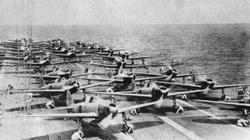 Aboard the Japanese aircraft carrier Akagi, the pilots warm up the engines of their Zero fighters prior to launching for the attack on Pearl Harbour.