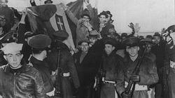 In March and April 1941 sixty five German and Italian ships that were in American ports were seized by the US authorities. Here Italian seaman, watched by US Soldiers, cheer and wave happily as their national flag is pulled down.