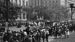 Crowds of Americans watch President Roosevelts funeral procession.