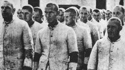 Internees at Dachau camp line up for work.