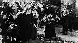 Women and children being cleared out of the Warsaw ghetto by the SS, ready for transport to Auschwitz.