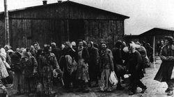 The Allies liberated Belsen Concentration Camp. Women, some still wearing their striped uniforms, prepare to leave.