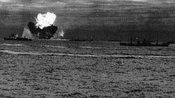 PQ-18 comes under attack. A British oiler explodes in flames as the rest of the group tries to keep formation.
