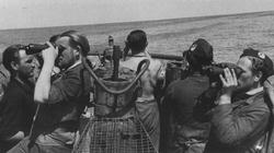 Lookouts on a U-boat scan the horizon for potential victims or Allied long-range anti-submarine aircraft.