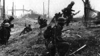A machine-gun team moves forward through the suburbs of Stalingrad.