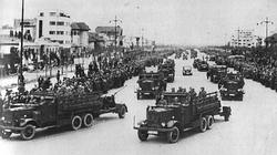 German troops parade through Bucharest during October 1940.