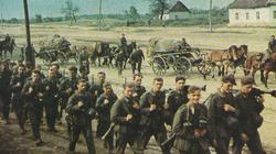 Fit and confident German infantrymen march through a Russian village in June 1941.