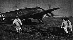 Arming of a He-111 takes place ready for a raid against England in early 1942.