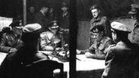 At Luneburg Heath on the 4th May 1945, Montgomery reads the surrender terms for German troops in the west to Admirals Wagner and Friedburg.