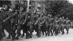 Members of the Milice march through Paris.