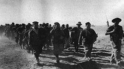 Italian troops taken by the Western Desert Force in December 1940, march in to captivity.