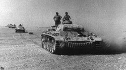 An Afrika Korps armoured column heads up to the front in late March 1941.