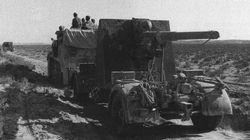 A German towed 88mm anti-aircraft gun moves forward in July 1942.